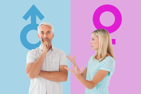 outraged: Unhappy couple having an argument with man not listening against pink and blue