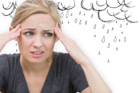 pounding head: Woman with headache against rain clouds