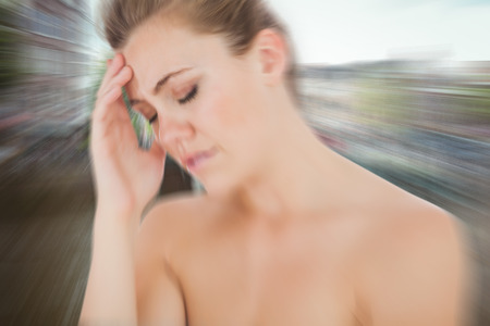 pounding head: Woman with headache against canal in amsterdam Stock Photo