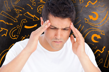 pounding head: Man with headache against black background