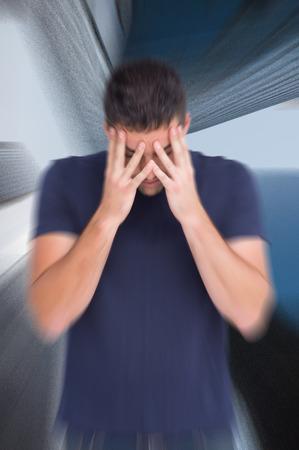 wincing: Man with headache against skyscraper