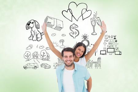 Happy casual man giving pretty girlfriend piggy back against green vignette photo