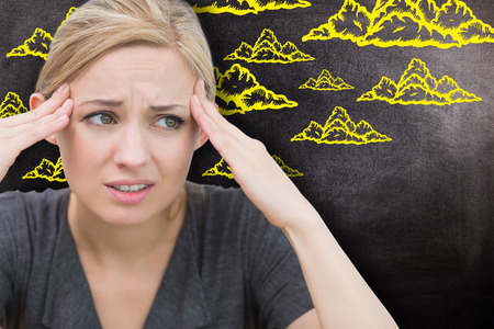 wincing: Woman with headache against black  Stock Photo