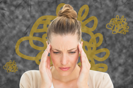 wincing: Woman with headache against squiggly line