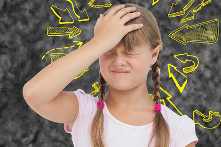 wincing: Little girl with headache against arrows Stock Photo