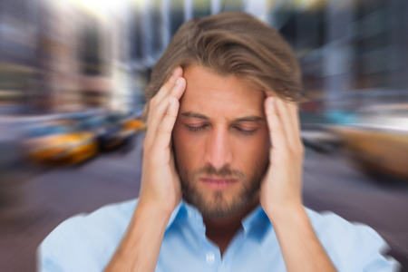 male headache: Man with headache against blurry new york street