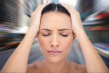 wincing: Woman with headache against blurry new york street