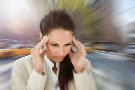 wincing: Woman with headache against new york street Stock Photo