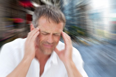 pounding head: Man with headache against new york street Stock Photo