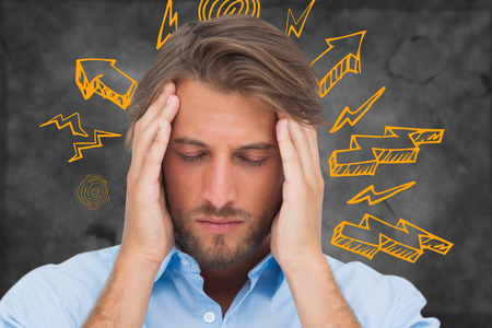 wincing: Man with headache against arrows Stock Photo