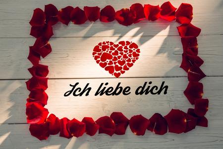 Liebe: ich liebe dich against frame of rose petals