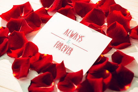 always: always and forever against card surrounded by rose petals