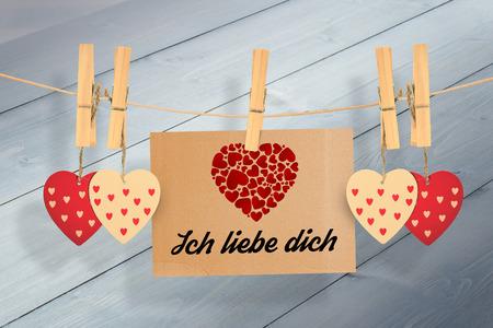in liebe: ich liebe dich against bleached wooden planks background