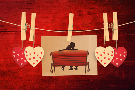 peg board: Couple on bench against red wooden planks