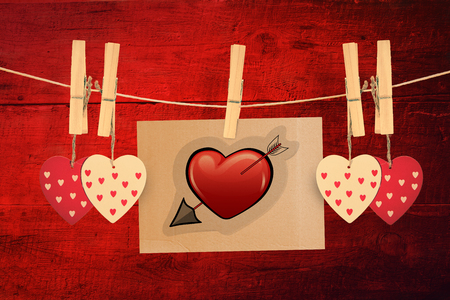 peg board: Heart with arrow against red wooden planks