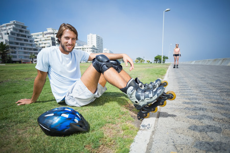 roller blade: Fit man getting ready to roller blade on a sunny day Stock Photo
