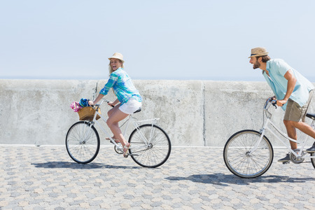 bikes: Cute couple on a bike ride on a sunny day Stock Photo