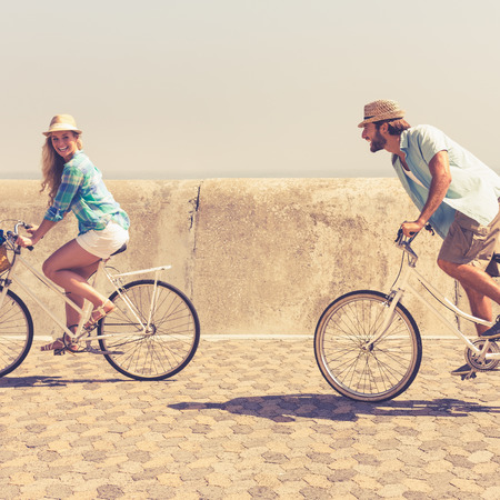 sunny sky: Cute couple on a bike ride on a sunny day Stock Photo