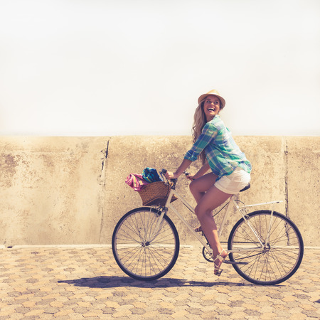 bike ride: Cute blonde on a bike ride on a sunny day