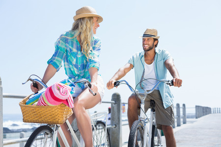 bike riding: Cute couple on a bike ride on a sunny day Stock Photo