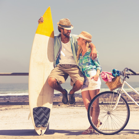 time off: Cute couple on a bike ride on a sunny day Stock Photo