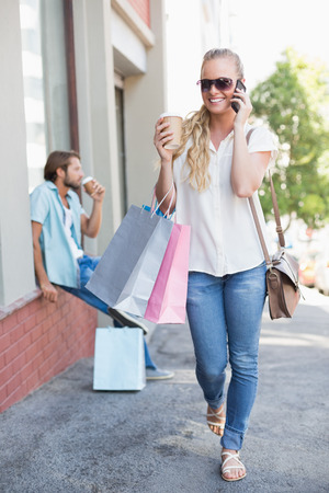 shopping trip: Attractive blonde on a shopping trip on a sunny day in the city
