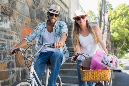 blonde couple: Attractive couple on a bike ride on a sunny day in the city