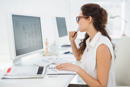 computer monitor: Concentrated businesswoman using computer monitor in the office