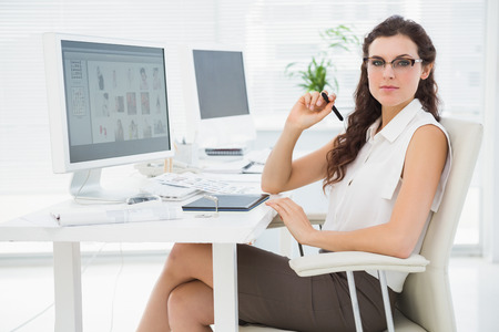 professional portrait: Pretty businesswoman using digitizer at desk in the office