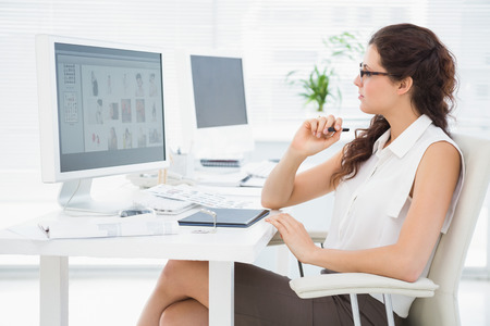 digitizer: Concentrated businesswoman using computer and digitizer in the office