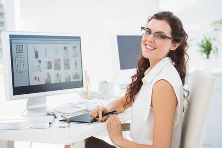 digitizer: Portrait of smiling businesswoman using digitizer in the office