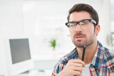 Concentrated casual businessman thinking in the office Stock Photo