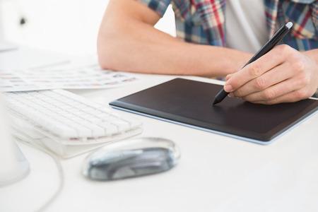 digitizer: Designer using digitizer at desk in the office