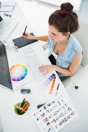 Designer working with colour wheel and digitizer in the office