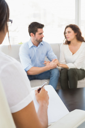 marriage counseling: Couple talking with their psychologist in the office
