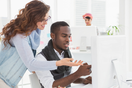 black business men: Smiling coworkers interacting and using computer in the office