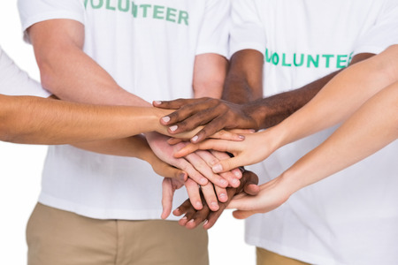 Teamwork with hands together standing on white background Stock Photo