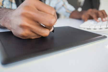 digitizer: Close up of businessman using digitizer in the office Stock Photo
