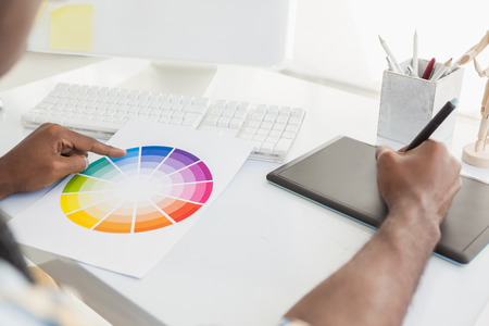 design: Businessman using colour sample and digitizer in the office Stock Photo