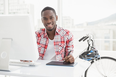 black professional: Casual businessman using digitizer and computer in the office Stock Photo