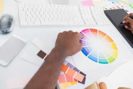 contact sheet: Designer using graphics tablet and colour wheel in the office