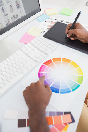 digitizer: Designer using colour wheel and digitizer in the office