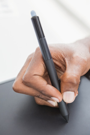 digitizer: Hand of designer using stylus and digitizer in the office
