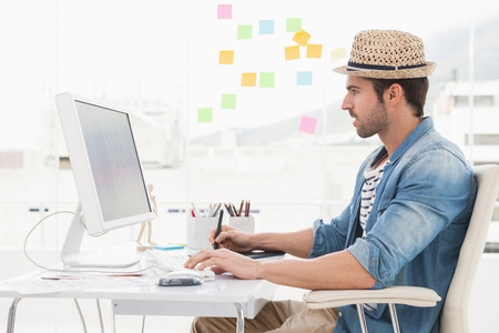 graphic designers: Casual designer using computer and digitizer in the ofice Stock Photo