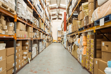 warehouse: Rows of shelves with boxes in a large warehouse Stock Photo