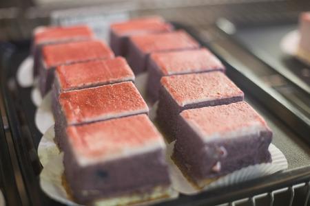 red velvet: Tray of red velvet cakes in the kitchen of the bakery