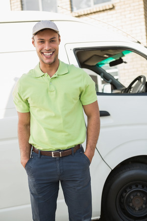 three quarter length: Three quarter length portrait of smiling man in front of delivery van Stock Photo