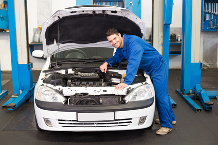 Mechanic examining under hood of car at the repair garage Imagens - 36349393