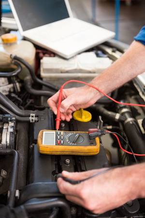 diagnostic tool: Mechanic using diagnostic tool on engine at the repair garage