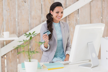 online shopping: Stylish brunette working from home in her home office Stock Photo